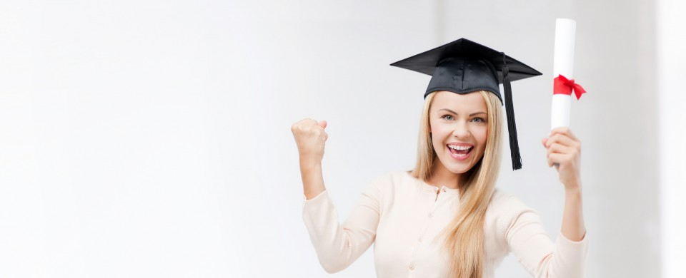 happy student in graduation cap with certificate